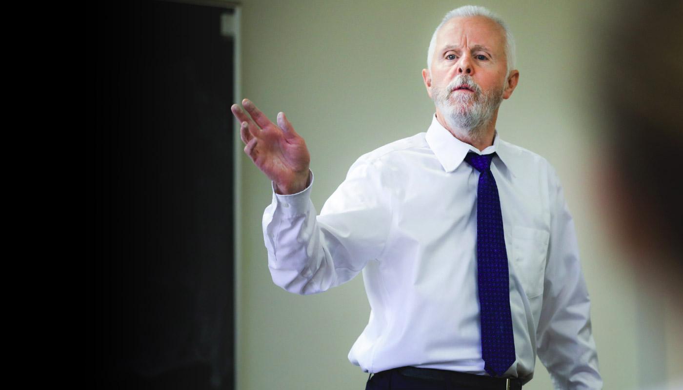 Professor speaking in front of classroom